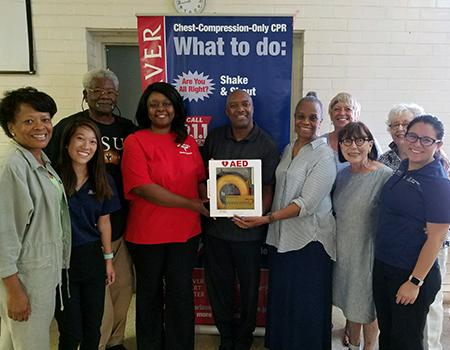 Members of Mt. Calvary Mission Baptist Church received an AED from the Gootter Foundation. UA students trained the group about chest-compression-only CPR and using an AED.