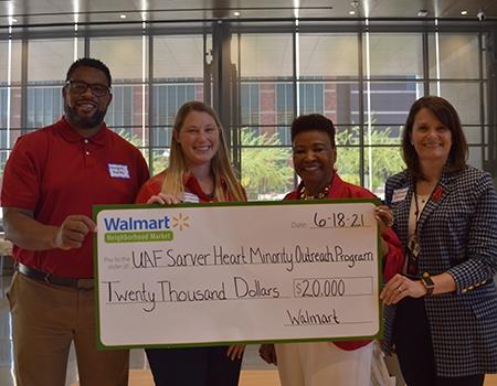 Marques Hunter, Dr. Amber Pate-Mozroll, Wanda Moore and Dr. Elizabeth Juneman