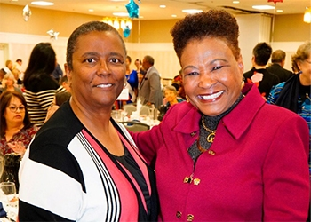 Cheryl Alli with Wanda F Moore, co-chair of the Sarver Heart Center Women's Heart Health Education Committee and chair of the Minority Outreach Program