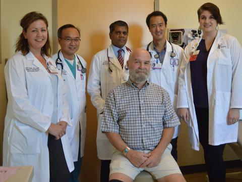 "Chip Rock (seated), the first ""low-risk"" TAVR patient at Banner – University Medical Center Tucson, came in for a follow-up appointment 11 days after the procedure and played golf on day 12, following the minimally invasive heart-valve replacement procedure. TAVR team members from left: Erin Scala, RN, BSN, Keng Pineda, MD, PhD, Kapil Lotun, MD, Toshinobu Kazui, MD, PhD and Devan Lodge, RN, MSc, CCRN."