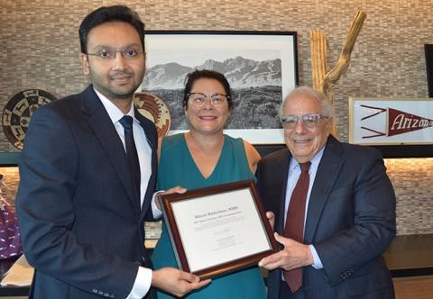 Maharesh Balakrishnan accepts the award from Dr. Nancy Sweitzer and Dr. Mark Friedman