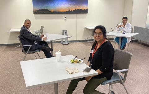 Drs. Preethi William, Tushar Acharya and Deepak Acharya practice physical distancing while taking a lunch break from their clinical work.