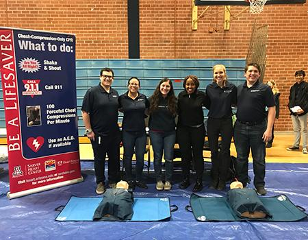 UA student volunteers taught chest-compression-only CPR at Pueblo High School's Family Night.