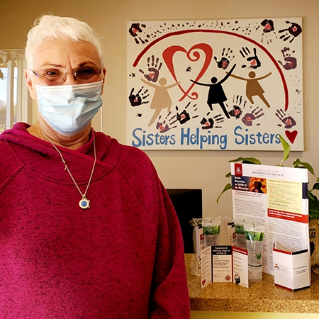 Sister Jean, director of Sister Jose Women's Shelter, displays items delivered by committee members.