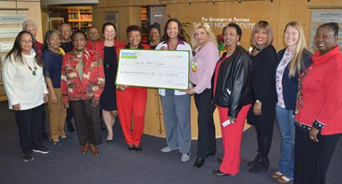 Members of the Sarver Heart Center Community Coalition for Heart Health Education receive a community grant from Walmart.